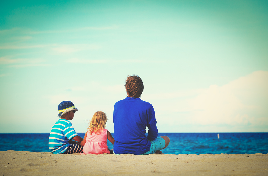 father with little son and daughter on beach, family at beach