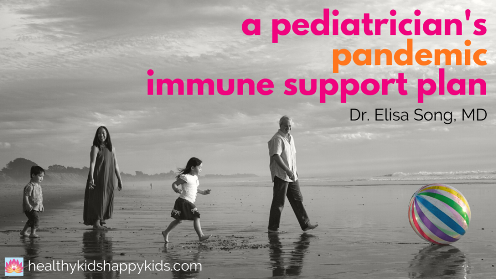 """Two children and 2 adults walking on beach. Picture titled """"A Pediatrician's Pandemic Immune Support Plan"""" Dr. Elisa Song"""